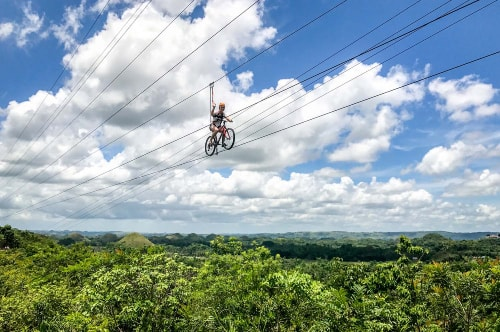Philippines-Bohol-Island-Chocolate-Hills-Adventure-Park-Zip-Lining-on-a-bike-17708 COVER