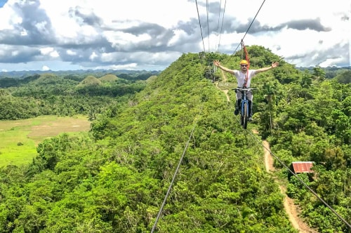 Philippines-Bohol-Island-Chocolate-Hills-Adventure-Park-Zip-Lining-on-a-bike-17744 COVER